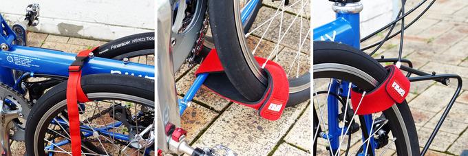 フロントホイールが3本の赤いベルトで車体に固定されている部分の3箇所の拡大写真。