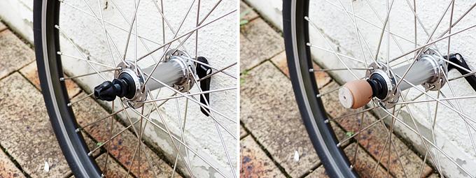 自転車から取り外されたフロントホイールのシャフト部分の先端にカバーが付けられている写真。