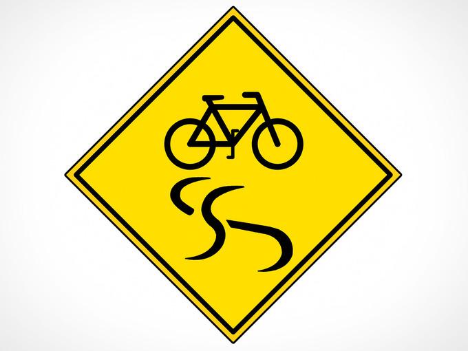 自転車がスリップしている様子を示した道路標識のようなイラスト。