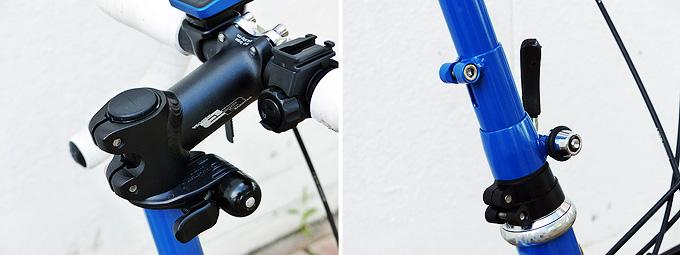 バイクフライデーの折り畳みミニベロ「ニューワールドツーリスト」のステムの写真。上下に長い青いパイプのてっぺんに、アヘッドステムとハンドルが付いていて、パイプの途中には長さ調整用ボルトが付いている。